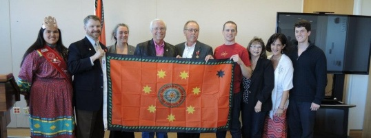 The 1st Cap City Leadership Council receives a Cherokee Nation flag from Chief Bill John Baker.